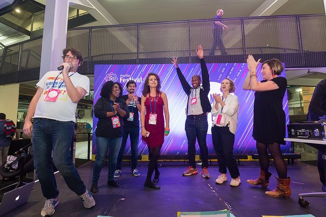 Participants celebrating onstage at MozFest