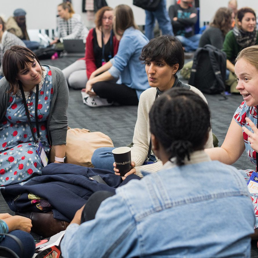 A group of four people sit in a circle during a session at MozFest
