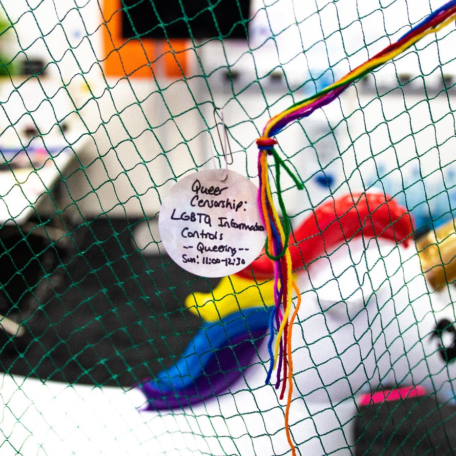 A unicorn in the MozFest Queering space, with a paper tag advertising a 'Queer Censorship' session