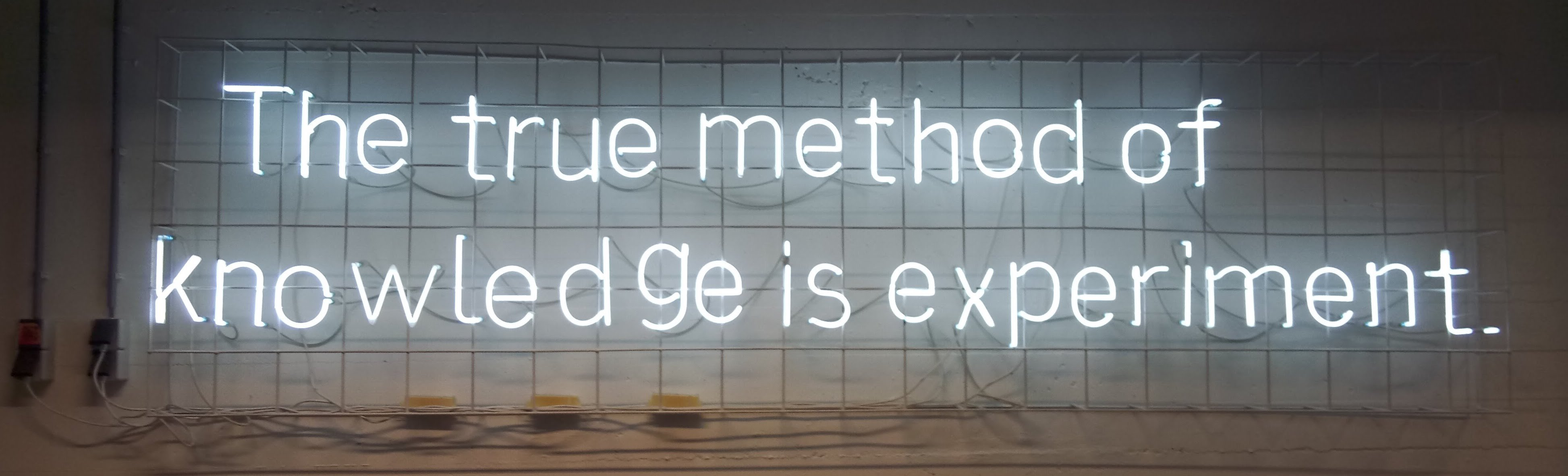 "Image of the  words ""The true method of Knowledge is experiment"" in Neon lights,taken in Baltan Labs, Eindhoven."