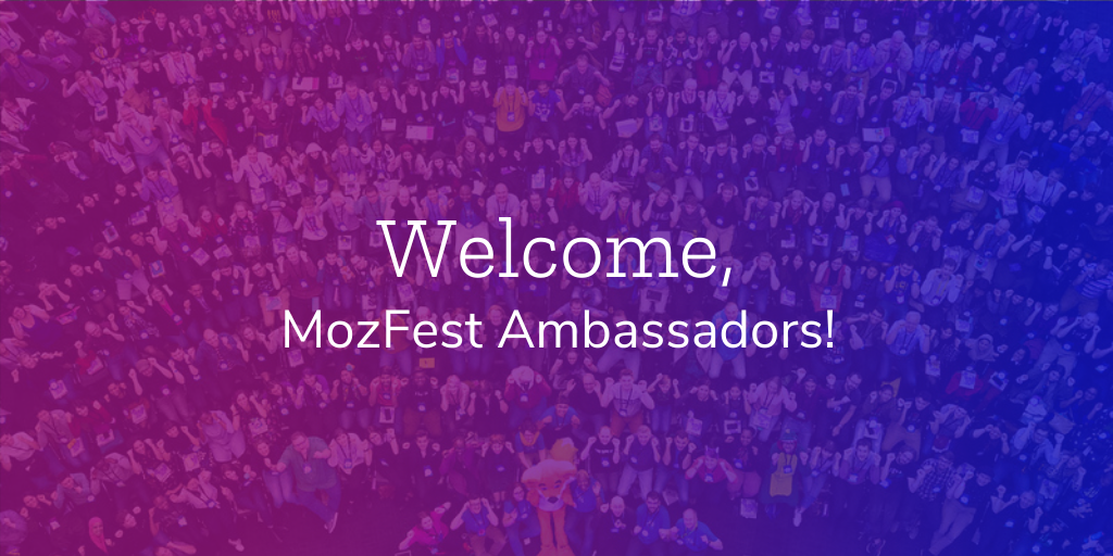 """""""Welcome MozFest Ambassadors!"""" in white text over a purple and blue gradient background, which includes a group photo from a past event."""