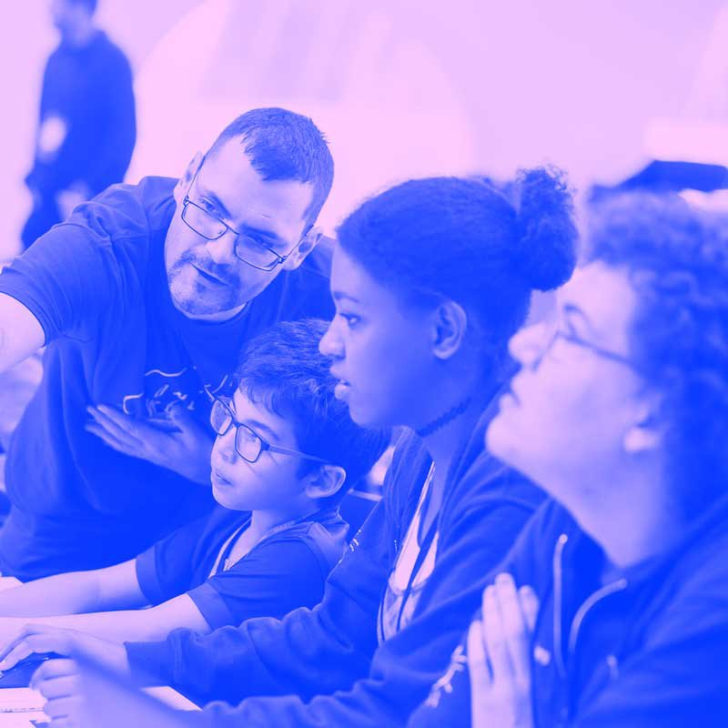 A session taking place at MozFest where a facilitator is supporting a group of young people