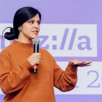 A speaker on stage at Mozilla Festival 2018